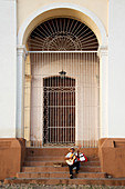 Man performing with his guitar on the steps of a church in Plaza Mayor, Trinidad, UNESCO World Heritage Site, Cuba, West Indies, Caribbean, Central America