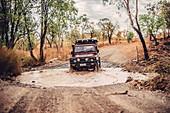 Cross-country river crossing in Purnululu National Park in Western Australia, Oceania;