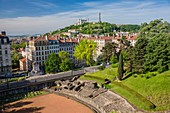 France, Rhone, Lyon, historical site listed as World Heritage by UNESCO, the district of Croix Rousse, the Amphitheater of the Trois Gaules, the Cathedral Saint Jean to the left and the basilica Notre-Dame of Fourviere on the hill of Fourviere
