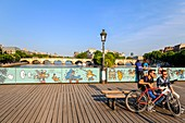 France, Paris, area listed as World Heritage by UNESCO, the Passerelle des Arts, tempory panels for railing decorated by street art