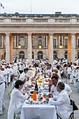 France, Paris, Palais Royal (Royal Palace), the Dinner in White takes place in a secret place, revealed in the last moment a Thursday in June