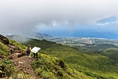 France, Guadeloupe (French West Indies), Basse Terre, Guadeloupe National Park, Saint Claude, hiking to the Soufriere volcano, panoramic view over the slopes of the volcano and the coast