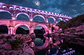 France, Gard, the Pont du Gard listed as World Heritage by UNESCO, Big Site of France, Roman aqueduct from the 1st century which steps over the Gardon, design light Guillaume Sarrouy