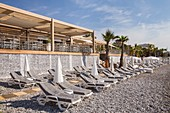 France, Alpes Maritimes, Cagnes sur Mer, sunbeds and parasols of the beach La Spiaggia