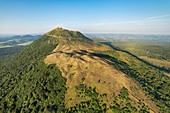 France, Puy de Dome, area listed as World Heritage by UNESCO, Orcines, Chaine des Puys, Regional Natural Park of the Auvergne Volcanoes, the Puy de Dome volcano (aerial view)
