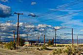 Telegraph poles and ruin on Salton Lake in California, USA