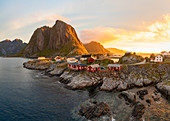 Red wooden huts, known as Rorbu, in the village of Reine on the Hamnoy island, Lofoten Islands. Rorbu is a Norwegian traditional house used by fishermen, today most are used by tourists.