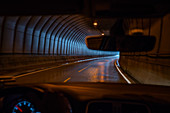 Driver's view, driving through a road tunnel, Lofoten Islands
