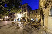 France, Gard, Pays d'Uzege, Uzes, the Place aux Herbes surrounded by arcaded houses and its outdoor cafes