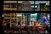 France, Paris, Quay of Jemmapes, La Vache dans les Vignes restaurant, consumers inside a restaurant