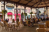France, Lot, Figeac, restaurant terrace under Carnot square covered market