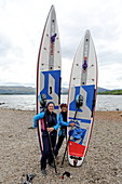 Stand-up paddle boarders at Loch Lomond, Highlands