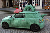 Mini Cooper in Nessy look as advertising stunt, High Street, Edinburgh