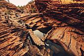 Rock formations in the Hamersley Gorge in Karijini National Park in Western Australia, Australia, Oceania;