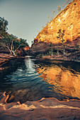 Man swims in the Hamersley Gorge in Karijini National Park in Western Australia, Australia, Oceania;