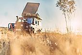 Off-road vehicle in the morning light in the Pilbara in Western Australia, Australia, Oceania;
