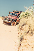 Four wheel drive vehicle in the outback near Coral Bay in Western Australia, Australia, Oceania;