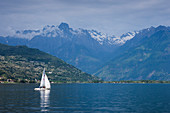 Lake Como with mountains and sailboat, Switzerland