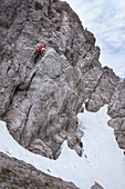 Man climbs on the rock in the via ferrata of the Wankspitze, Mieminger Kette, Tyrol