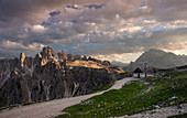 Mountain landscape in the Dolomites below the Three Peaks with chapel and path in the sunset, South Tyrol