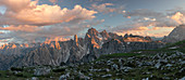 Panoramic mountain landscape with alpine glow in the Dolomites below the Three Peaks in the sunset, South Tyrol