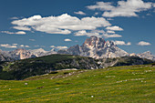 Mountain landscape in the Dolomites below the Three Peaks with sun and clouds, South Tyrol