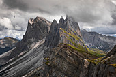 Dramatic Seceda mountainside with thick clouds in the Dolomites near Ortisei, South Tyrol