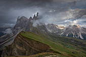 Mountainside Seceda with thick clouds in the Dolomites near Ortisei, South Tyrol