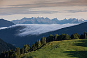 Low clouds move over a mountain range in the Dolomites, South Tyrol