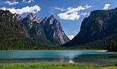 Turquoise mountain lake Toblacher See with sun in summer in the Dolomites, South Tyrol