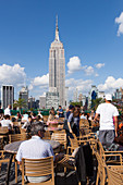 PERSPECTIVE OF THE EMPIRE STATE BUILDING AND THE BUILDINGS OF MIDTOWN FROM THE TERRACE OF THE 230 FIFTH ROOFTOP BAR, MIDTOWN MANHATTAN, NEW YORK CITY, NEW YORK, UNITED STATES, USA