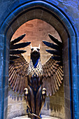 PHOENIX STATUE AT THE ENTRANCE TO DUMBLEDORE'S OFFICE, STUDIO TOUR LONDON, THE MAKING OF HARRY POTTER, WARNER BROS, LEAVESDEN, UNITED KINGDOM