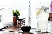 Olives and lemonade in a harbor restaurant in Calvi, Corsica, France.