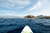 View from a stand-up paddle board at the citadel of Calvi, Corsica, France.