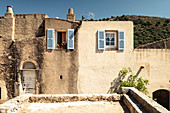 Facades of houses in the mountain village of Pigna near Calvi, Corsica, France