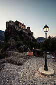 "Citadel and street lamp at dusk, Corte, ""the secret capital of Corsica"", Corsica, France."