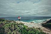 Surfers on the bay of Contos at Margaret River, Western Australia, Australia, Oceania