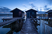 View of fishing huts in Lake Starnberg at the blue hour, Starnberg; Bavaria; Germany; Europe