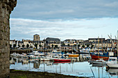View from Ville Close to the Bay of Concarneau with colorful boats, Concarneau, Arrondissement Quimper, Departement Finistere, Brittany, France, Europe