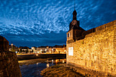 View of Concarneau city center with clock tower at Ville Close (closed city) at dusk, Concarneau, Arrondissement Quimper, Departement Finistere, Brittany, France, Europe