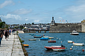 View from Quai Peneroff with people and colorful boats to Ville Close, Concarneau, Arrondissement Quimper, Departement Finistere, Brittany, France, Europe