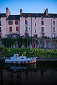 Evening mood at the blue hour in Redon on the Canal de Nantes Brest with houseboat and house facades, Ille-et-Vilaine department, Brittany, France, Europe