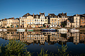 Houses front reflected in the water of the Vilaine in the morning, Redon, Ille-et-Vilaine department, Brittany, France, Europe