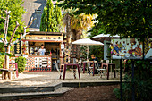 Dreamy garden cafe in La Gacilly, Morbihan department, Brittany, France, Europe