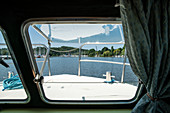 View through front houseboat window onto the Vilaine river, Port Folleux, Morbihan department, Brittany, France, Europe