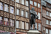 Statue of Jean Leperdit in front of the historic half-timbered houses on the Place du Champ Jacquet, Rennes, Ille-et-Vilaine department, Brittany, France, Europe