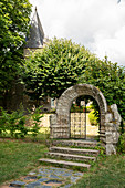 Historic stone gate to the garden in the castle park of Rochefort en Terre, Morbihan department, Brittany, France, Europe