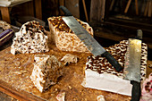 Breton specialty nougat with honey caramel and butter on a large wooden board for tasting, Rochefort en Terre, Morbihan department, Brittany, France, Europe