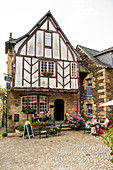 Romantic half-timbered restaurant with guests at the tables, Rochefort en Terre, Morbihan department, Brittany, France, Europe