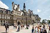 Children play with soap bubbles in front of the Hotel De Ville, the largest city hall in Europe, Hotel De Ville, Paris, France, Europe